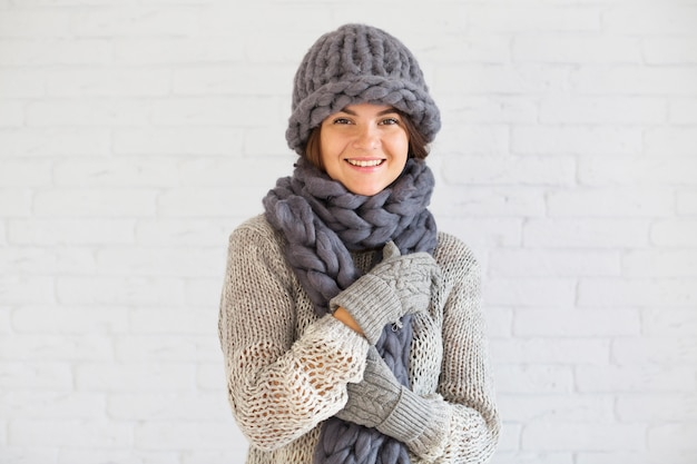 Smiling lady in mitts, hat and scarf