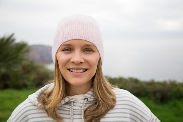 Smiling lady wearing sportswear and relaxing outdoors