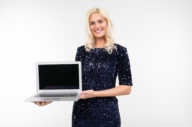 Smiling lady with laptop with mockup in hands on white background with copy space