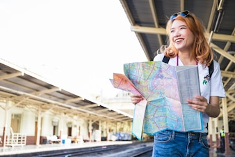 Smiling lady with map on platform