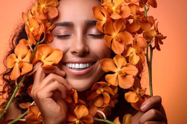 Улыбающаяся дама с оранжевыми цветами возле ее лица