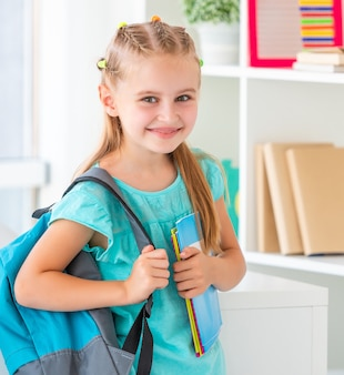 Smiling little girl ready back to school