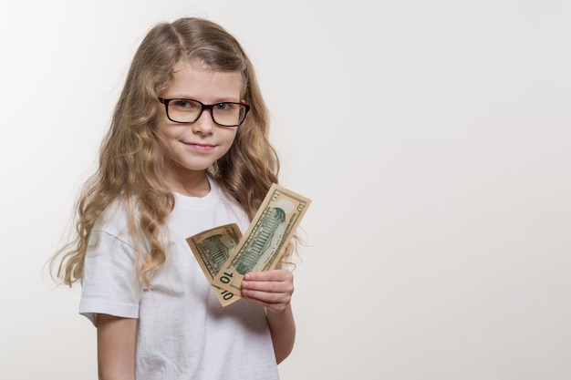 Smiling little girl with cash, white
