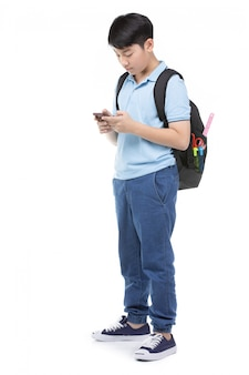 Smiling little student boy in blue polo