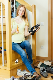 Smiling long-haired woman with shoes