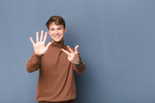 Smiling and looking friendly, showing number eight or eighth with hand forward, counting down