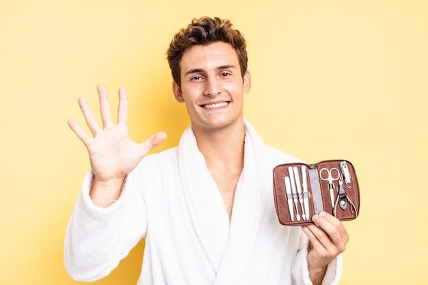 Smiling and looking friendly, showing number five or fifth with hand forward, counting down. nails tools case concept