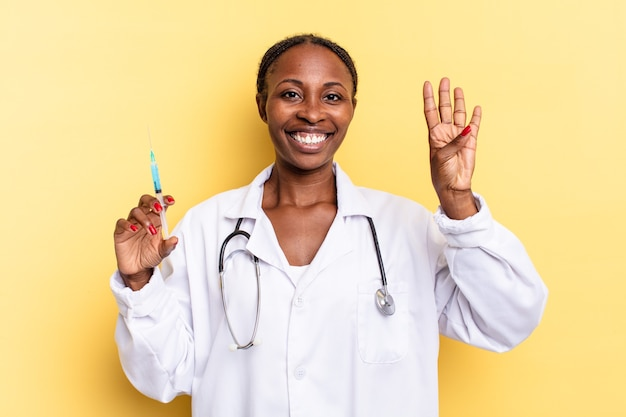 Smiling and looking friendly, showing number four or fourth with hand forward, counting down. physician and syringe concept