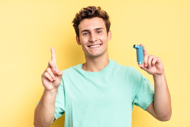 Smiling and looking friendly, showing number one or first with hand forward, counting down. asthma concept