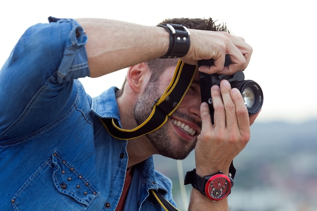 Smiling male photographing