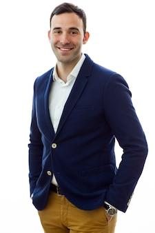 Smiling man in blue jacket in studio