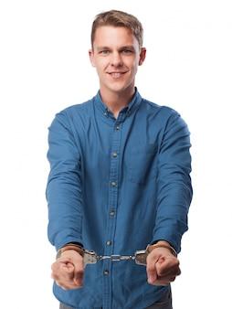Smiling man cuffed