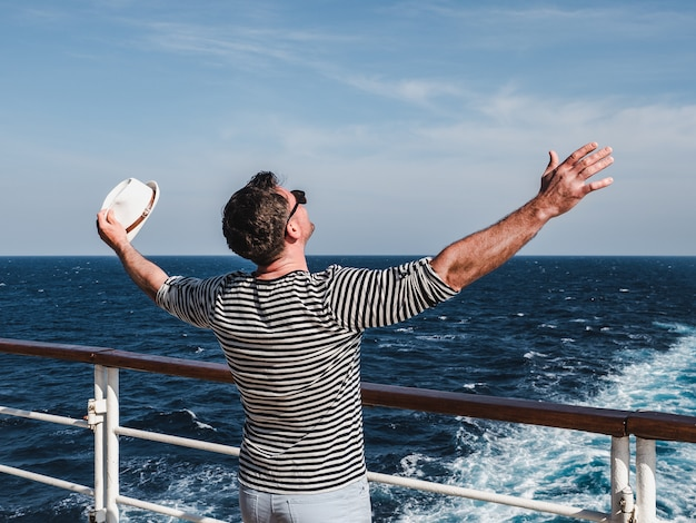 Smiling man on the empty deck of a liner
