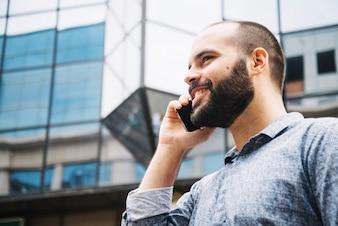 Smiling man enjoying phone talking