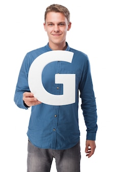 Smiling man holding the letter