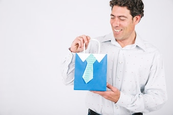 Smiling man holding present