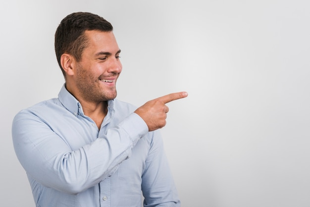 Smiling man looking on one side with copy space
