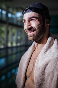 Smiling man looking at something at the pool