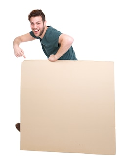 Smiling man pointing to blank poster