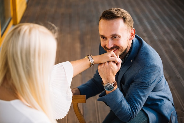 Smiling man proposing to her girlfriend for marriage
