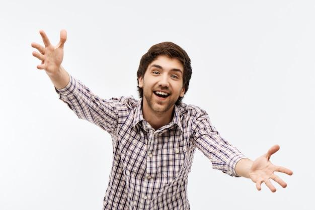 Smiling man reaching hands forward to hug