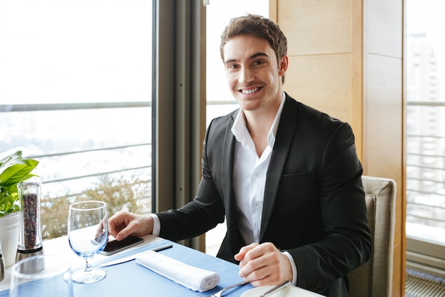 Smiling man in restaurant