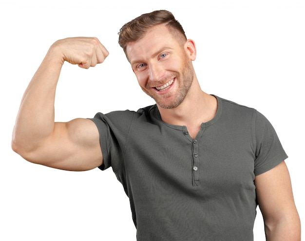 Smiling man showing biceps