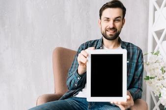 Smiling man showing tablet