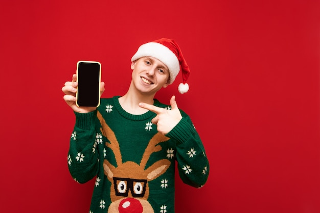 Smiling man showing thumbs up on black smartphone screen