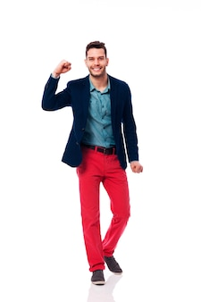 Smiling man showing victory sign