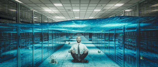 Smiling man sitting on the floor of a flooded server center.