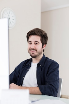 Smiling man sitting in office