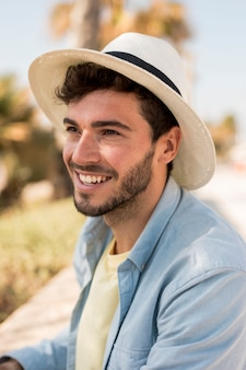 Smiling man wearing a hat