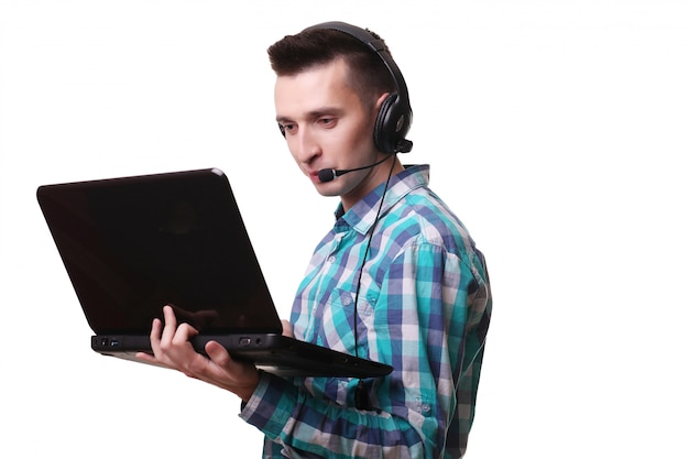 Smiling man wearing a headset on white wall