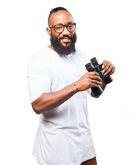 Smiling man with a binoculars