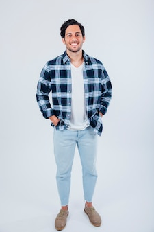 Smiling man with hands in pocket