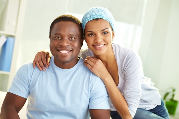 Smiling man with his girlfriend