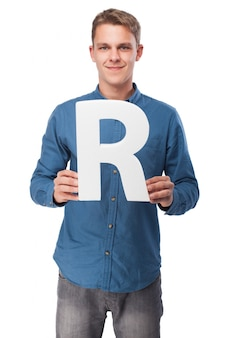 Smiling man with the letter