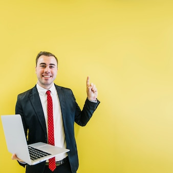Smiling man with solution on yellow