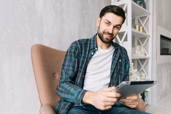 Smiling man with tablet