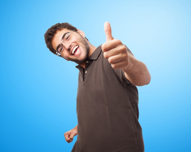 Smiling man with thumb up
