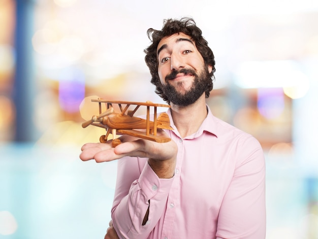 Smiling man with a wooden plane
