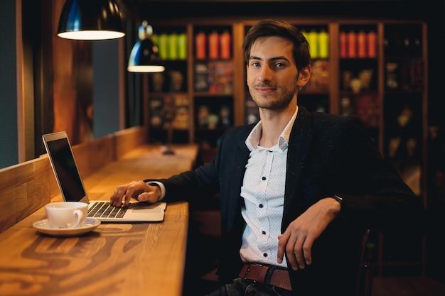 Smiling man working on laptop