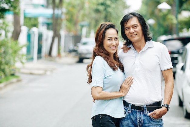 Smiling middle-aged vietnamese couple