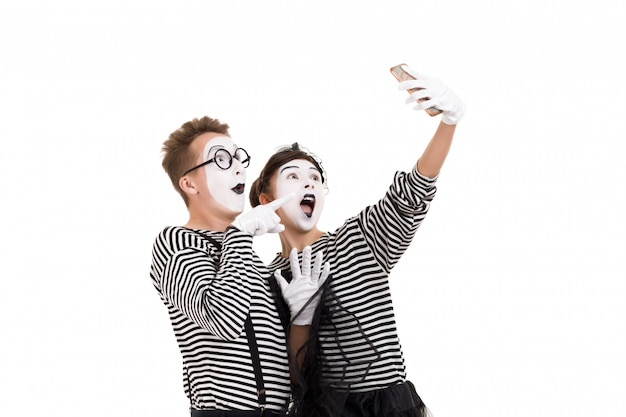 Smiling mimes in striped shirts.