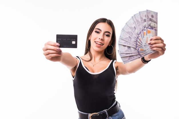 Smiling model in black shirt hold fan of dollar bills and a credit card