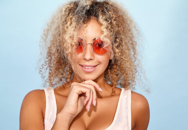 Smiling model in trendy summer clothes  in sunglasses
