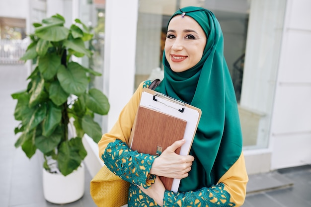 Smiling muslim young businesswoman