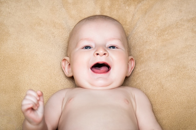 Smiling naked baby