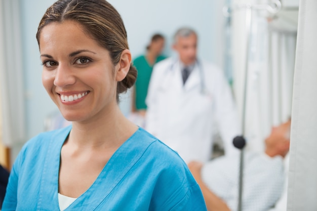 Smiling nurse in hospital room